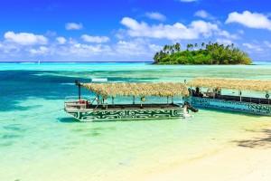 Rarotonga, Cook Islands. Motu Island and boats at the Muri Lagoon.